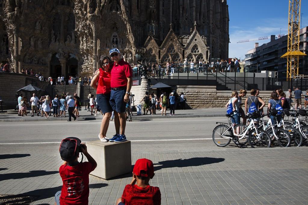 tourists posing for a snapshot outside Sagrada Familia